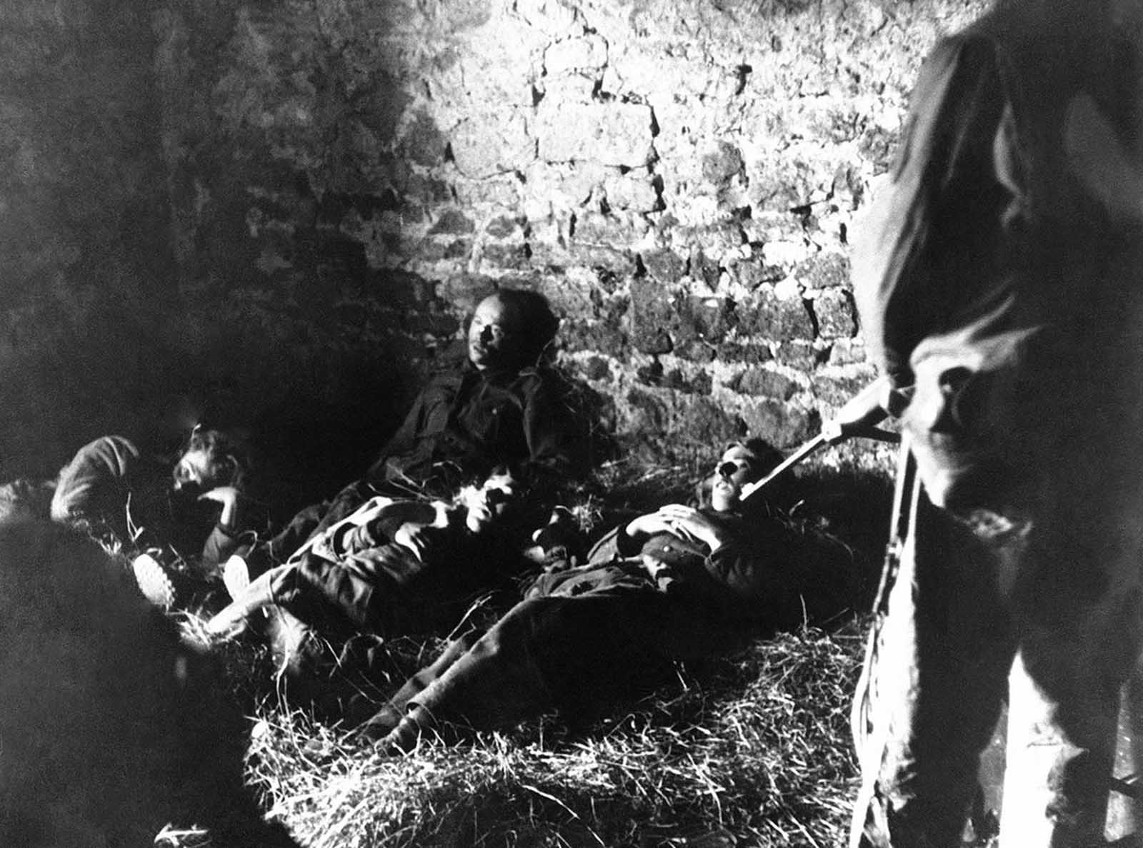These five Germans were wounded and left without food or water for three days, hiding in a Normandy farmhouse waiting for a chance to surrender. Acting on information received from a French couple, U.S. soldiers went to the barn only to be attacked by snipers who seemed determined upon preventing their comrades from falling into Allied hands. After a skirmish, the snipers were dealt with and the wounded Germans taken captive, in France on June 14, 1944.