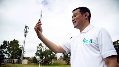Source: Singtel. An Optus engineer at Optus' live 5G site in Sydney, Australia uses a OPPO 5G test device during a 5G AR video call to Singtel engineers in Singapore.