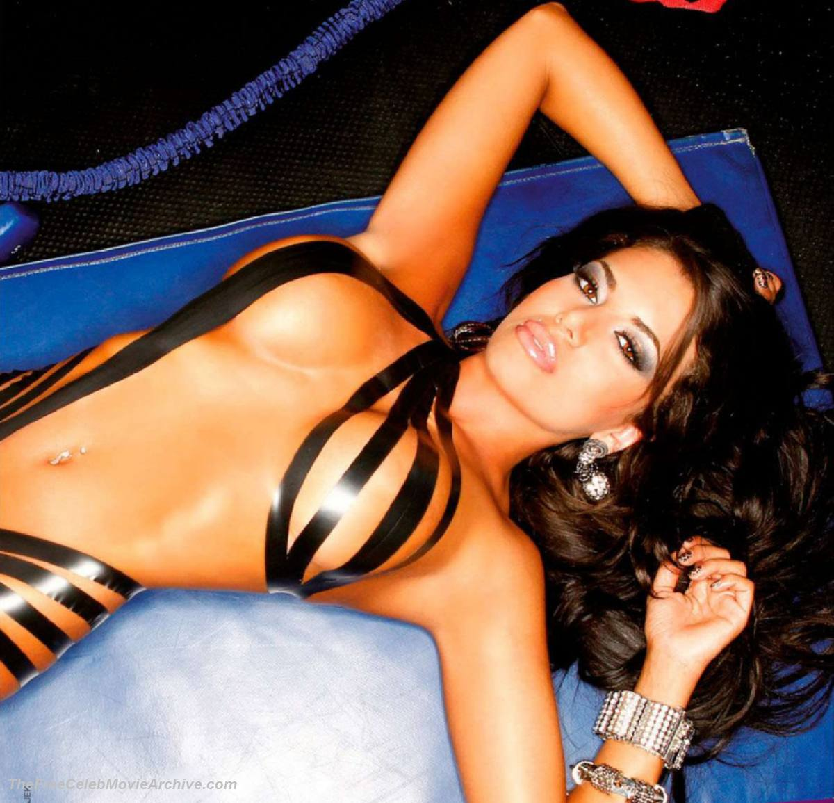 Veena malik bares it all for fhm