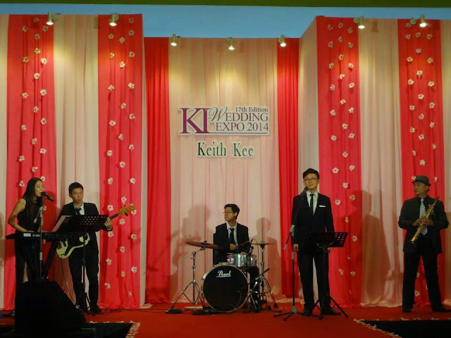 performers in black formal wear suit