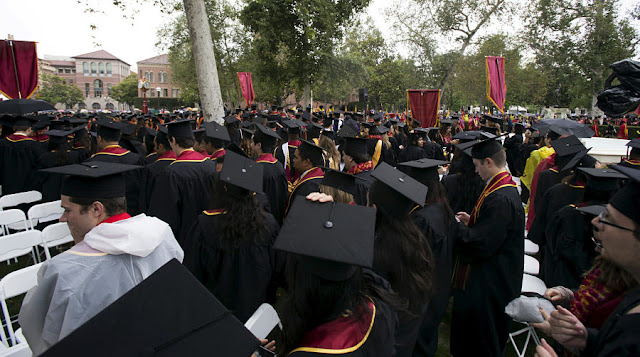 Image Attribute: Graduating students attend USC's Commencement Ceremony at the University of Southern California in Los Angeles, California, May 15, 2015. REUTERS/Mario Anzuoni/File Photo
