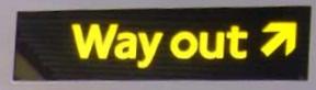 Indicación de salida al exterior en el metro de Londres.