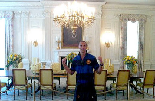 Rio Ferdinand poses inside the White House as part of Manchester United's pre-season tour