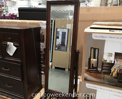 Store your jewelry and get dressed in front of the Universal Broadmoore Cheval Mirror