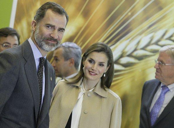 Queen Letizia wore ZARA Cape Jacket, Hugo Boss boots, BOSS Bespoke Bag, Tous earrings