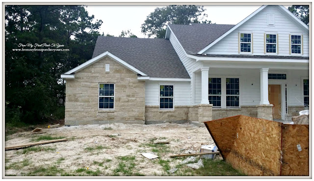 Building A Suburban Farmhouse-David Weekley-Rock On Front Of Home-Building Process
