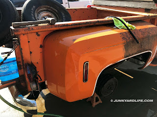 The orange bed shines after layers of surface rust and grime are removed.