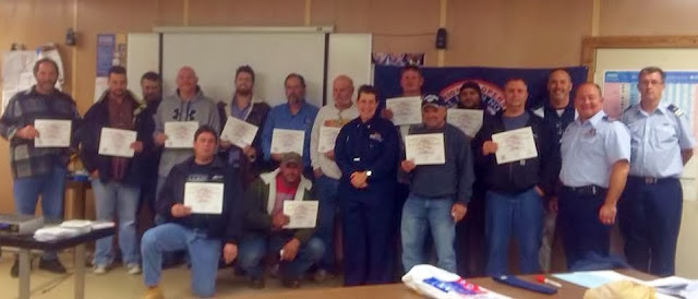 Happy Graduates with their Instructors