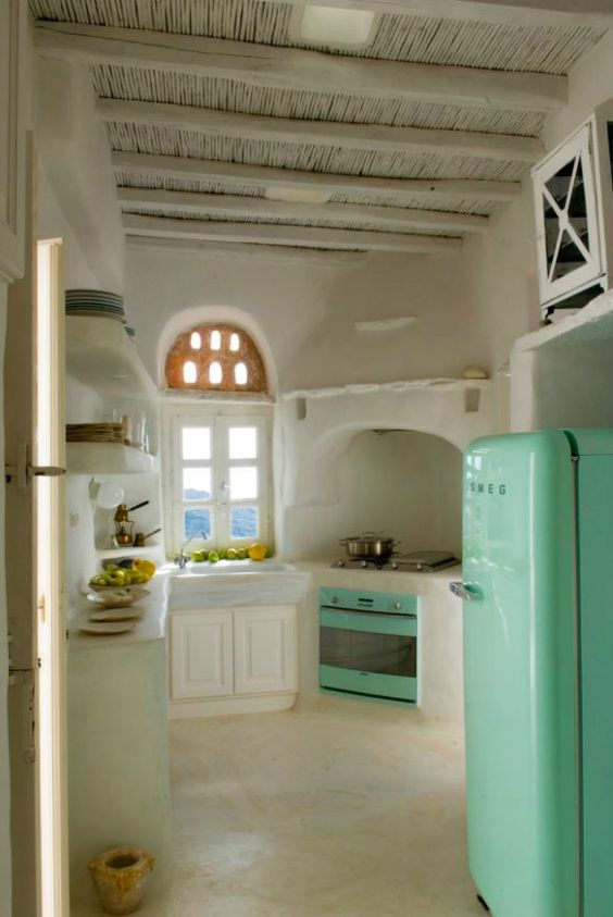 Drooling over the mint green appliances and those beams in this lovely kitchen