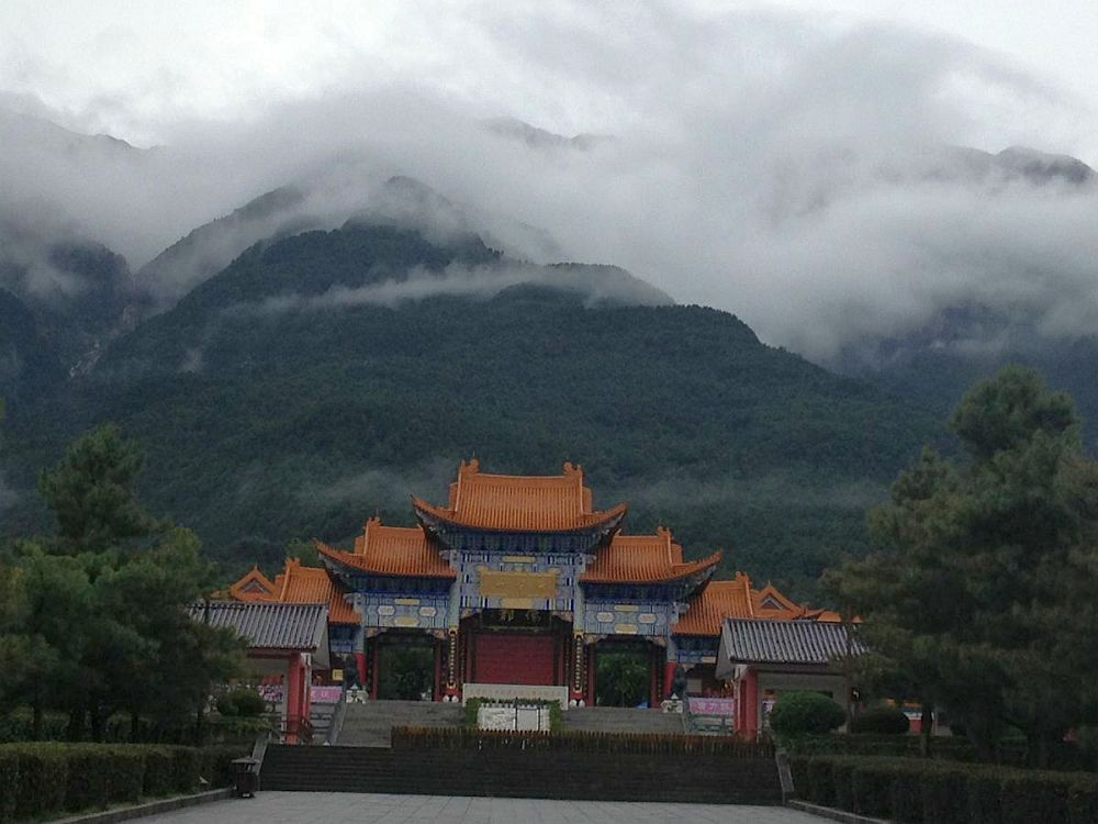 clouds roll over mountains scenery temle