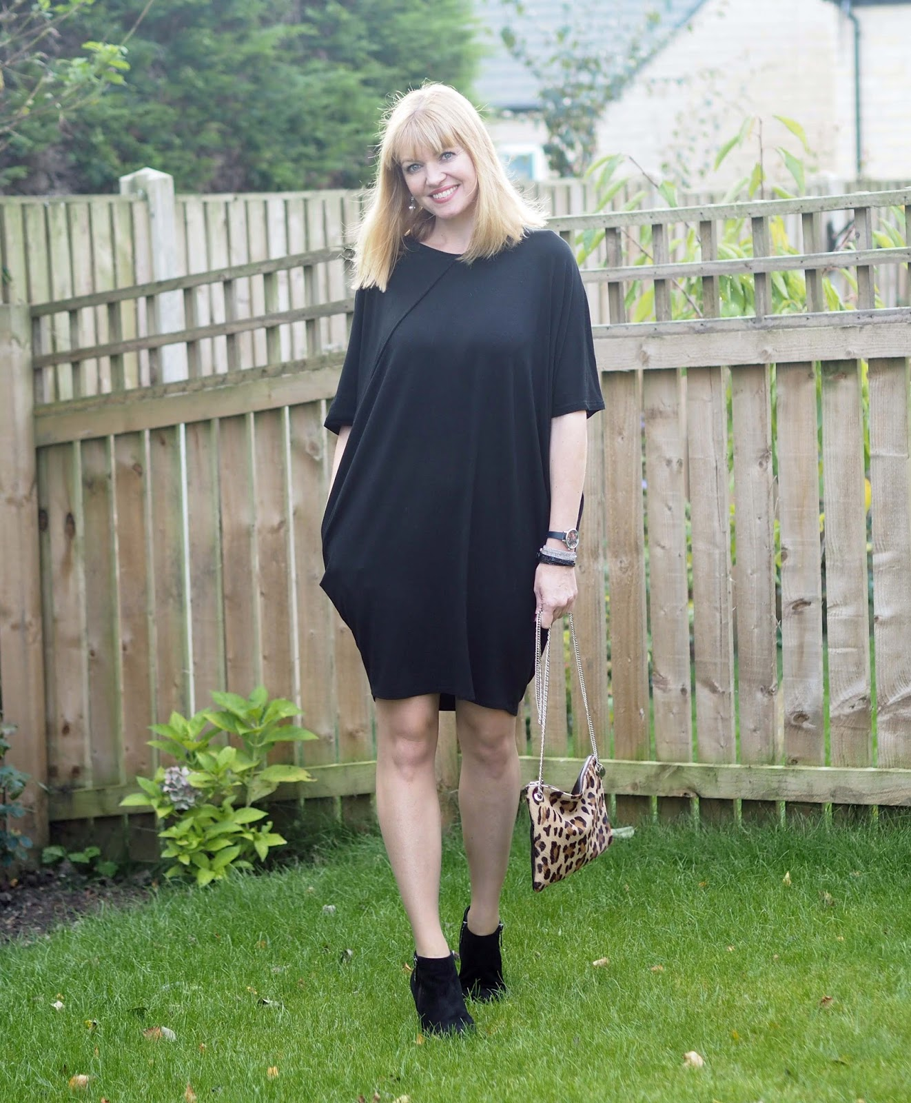 Hope cocoon dress with pockets worn with high-heeled ankle boots and printed tights, pantyhose