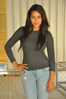 Actress Bhanu Tripathri Pos in Ripped Jeans at Iddari Madhya 18 Movie Pressmeet  0050.JPG