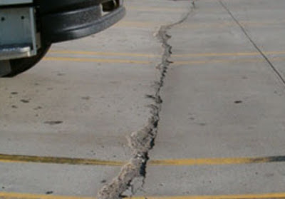 A slab-on-grade foundation distressed resulting curling and heavy trucks make factures in concrete slab