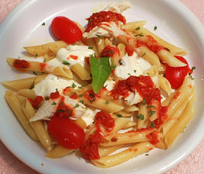 This is an Italian pasta dish made with penne pasta, tomatoes and mozzarella like a  caprese style sauce over pasta with fresh basil