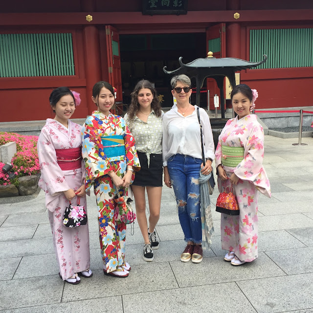 Taking photo with traditionally dresses young women