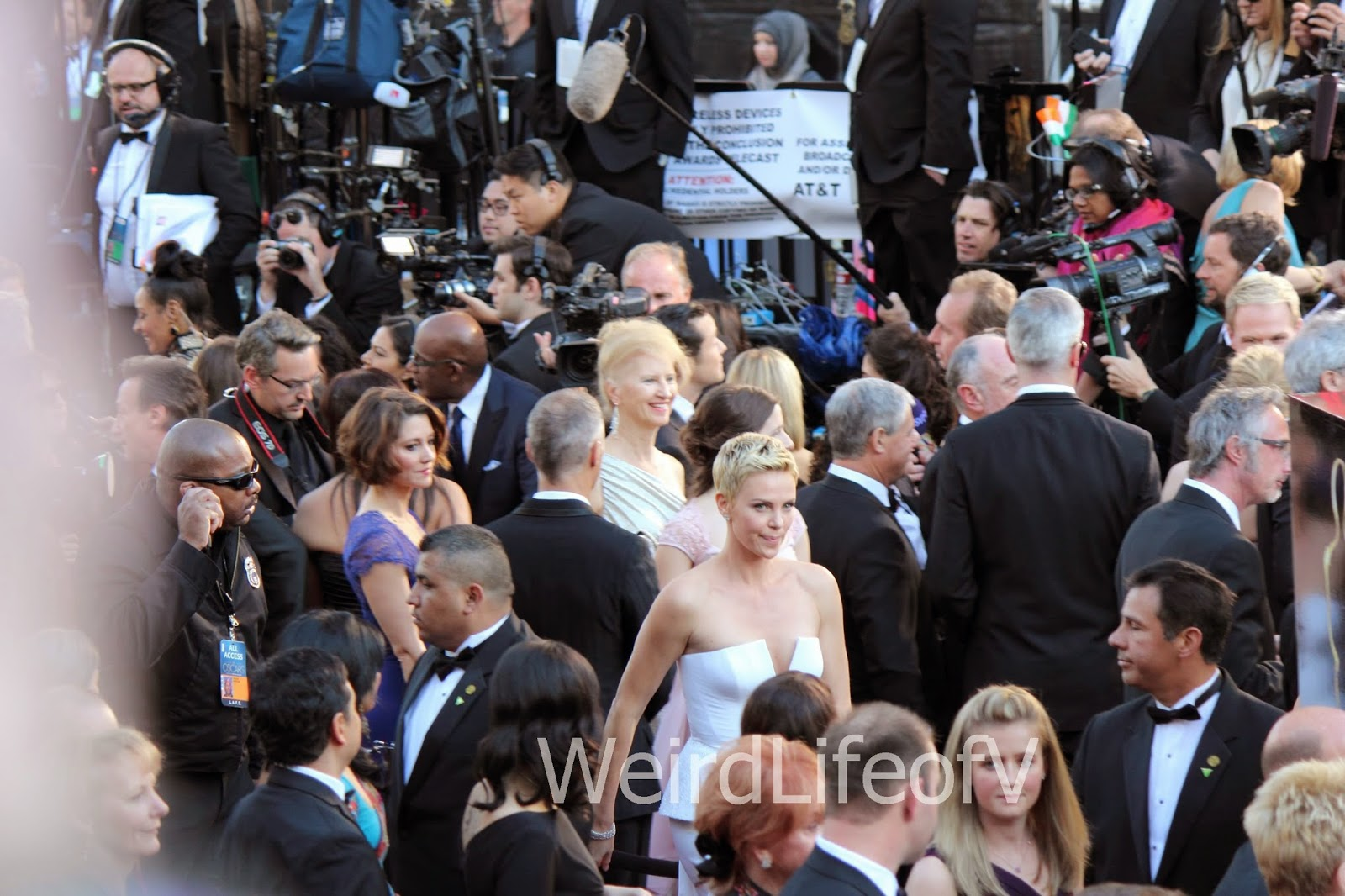 Charlize Theron rushing through the crowd