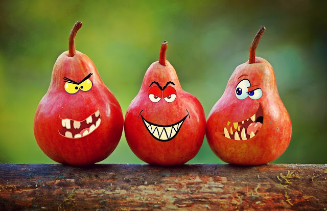 three pears, with evil, angry looking faces.