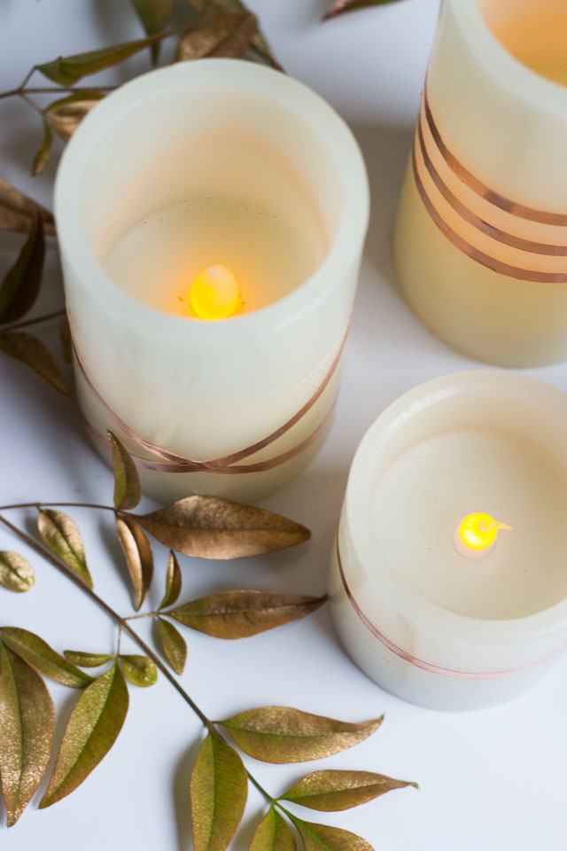 Wrap flameless LED candles with copper foil tape for a gorgeous look - perfect for fall or your Thanksgiving table!
