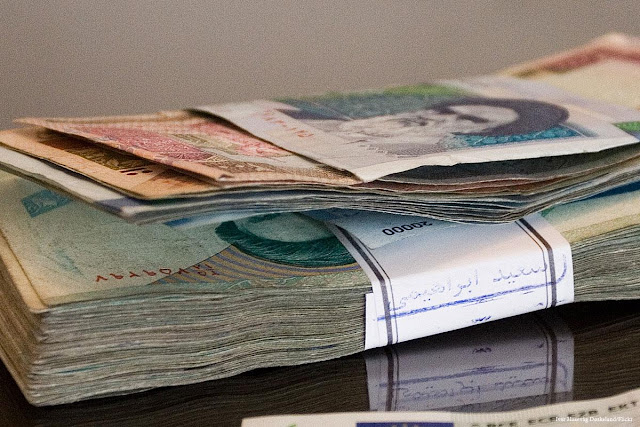 Image Attribute: Iranian riyal / Source: Ivar Husevåg Døskeland/Flickr, Creative Commons