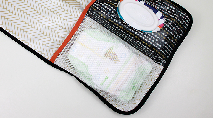 Love the fabrics on this TUTORIAL: On-the-Go Changing Pad & Diaper Caddy | The Inspired Wren