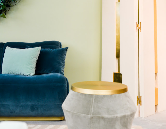 Navy velvet sofa and grey velvet table with brass details by Munna at Decorex during London Design Festival 2016 #LDF16