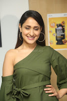 Pragya Jaiswal in a single Sleeves Off Shoulder Green Top Black Leggings promoting JJN Movie at Radio City 10.08.2017 097.JPG