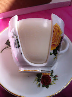 Broken teacup candle