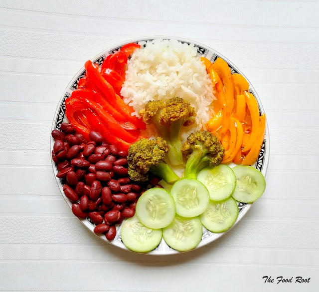 This satisfying bowl of goodness is filled with rice, red kidney beans, broccoli, bell peppers and cucumber.