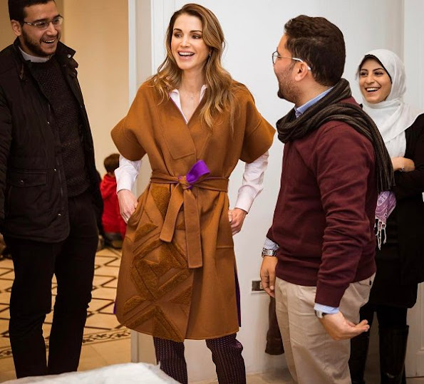 Queen Rania met with the members of the Phi Science Institute. Queen wore Fendi Dress and Balmain Coat, yellow suede shoes