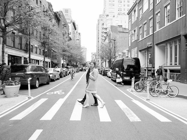 Ted and Liz cross the street in NYC in black and white