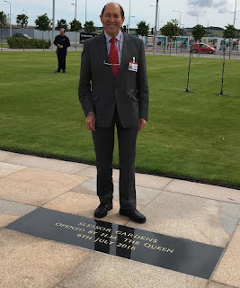 Councillor Laurie Bidwell beside the commemorative plaque in Slessor Gardens Dundee unveiled by The Queen on Wednesday 6 July 2016
