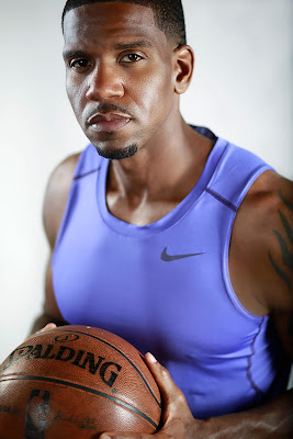 A close up portrait of a male basket ball player in a studio environment