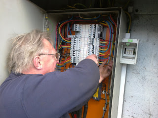 John continuing the scheduled inspection of electrical systems