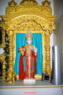 Image for poem 'Nayanabhiram' Ghanashyam Maharaj Murti in BAPS Swaminarayan Temple, Dhule