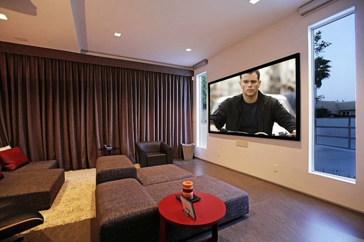 Home theater in Modern Beverly Hills House with open interiors