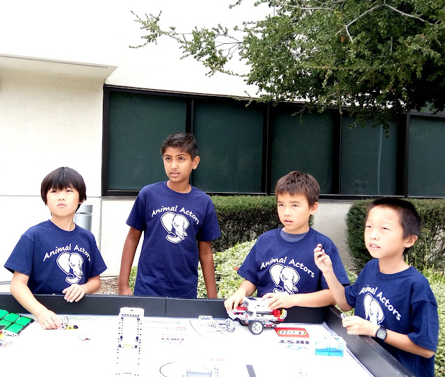 community sharing at the library discussing FLL robotics competition