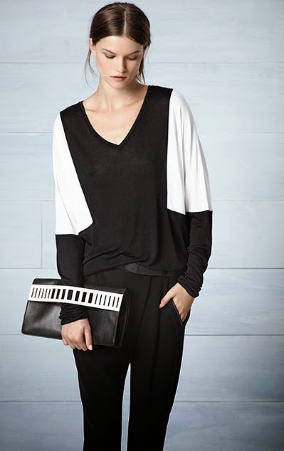 Vince black and white blouse and black trousers