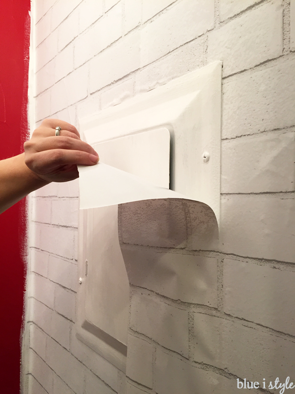 Installing temporary wallpaper around fixtures and outlets