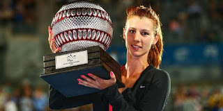 Tsvetana showcases the trophy to her fans in the podium