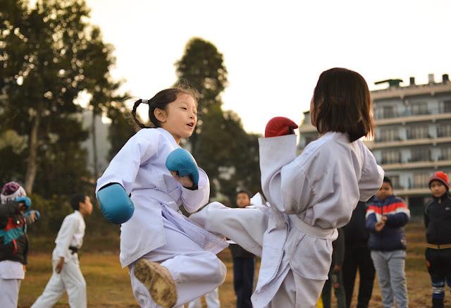 Children practising kick boxing
