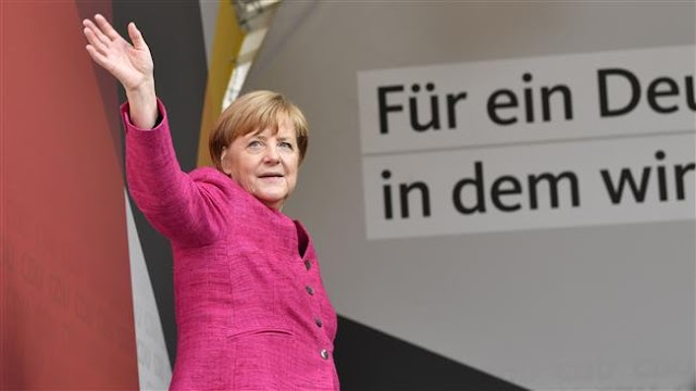Germany's Chancellor Angela Merkel wins 4th term in office as far-right wins parliamentary seats