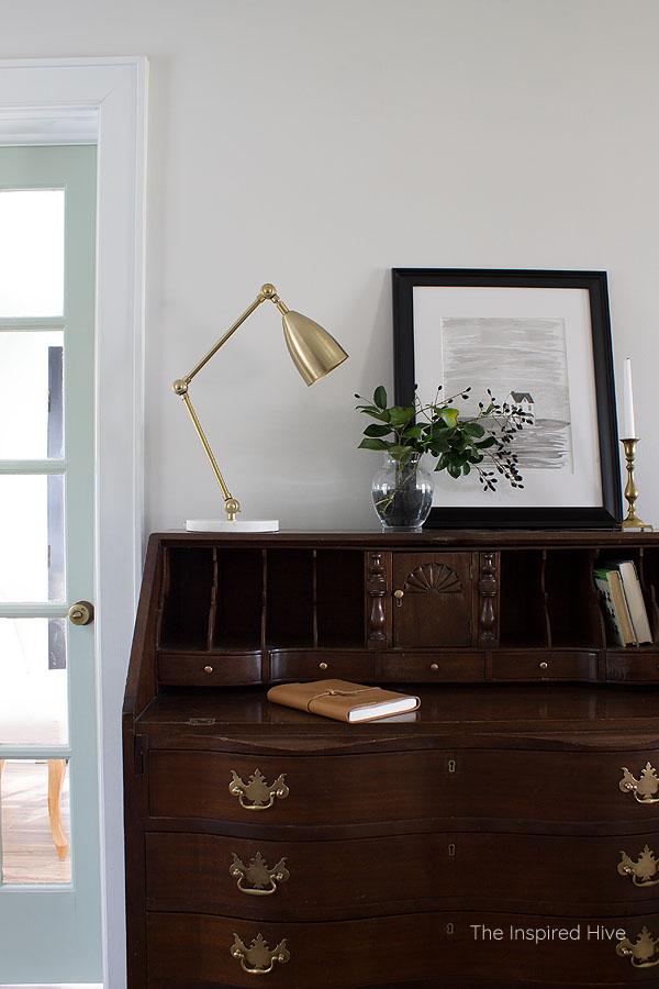 Antique secretary desk with polished brass hardware