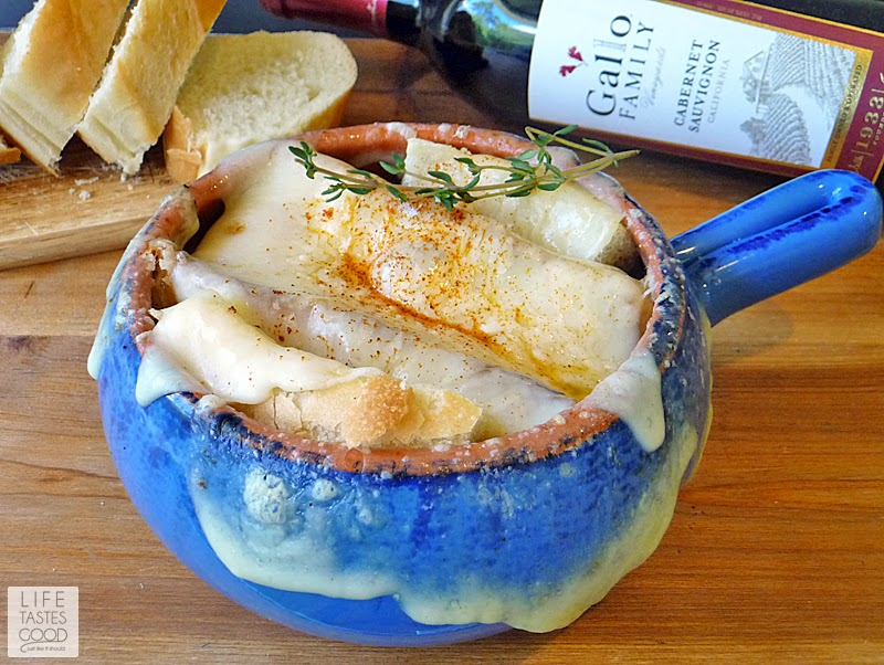 Cheesy French Onion Soup | by Life Tastes Good is a delicious blend of caramelized onions, herbs, toasted garlic bread, and lots of melty cheese. #SundaySupper #ComfortFood