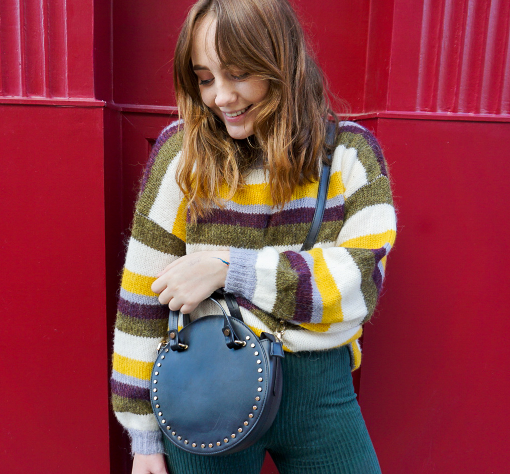 girl wearing topshop striped oversized jumper and green corduroy flared trousers for fall 2018