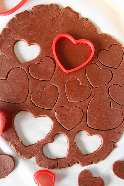 Rolling and Cutting Chocolate Sugar Cookies Image