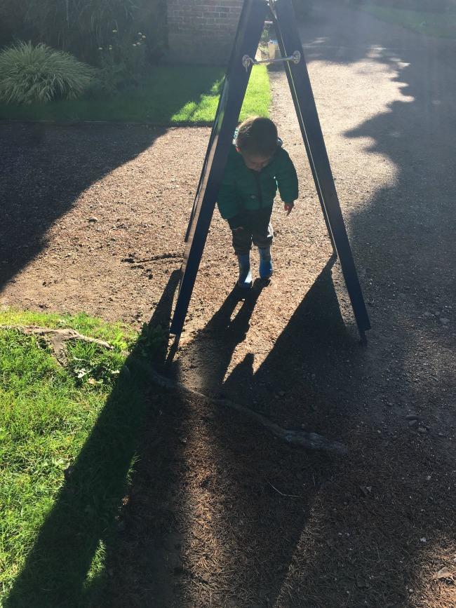 Birthday-boy-toddler-walkinh-under-sign