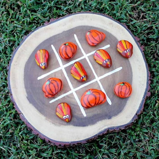 painted rock tic tac toe with turkeys and pumpkins