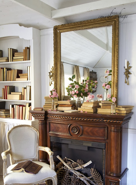cottage spring mantel with blush flowers and antique books