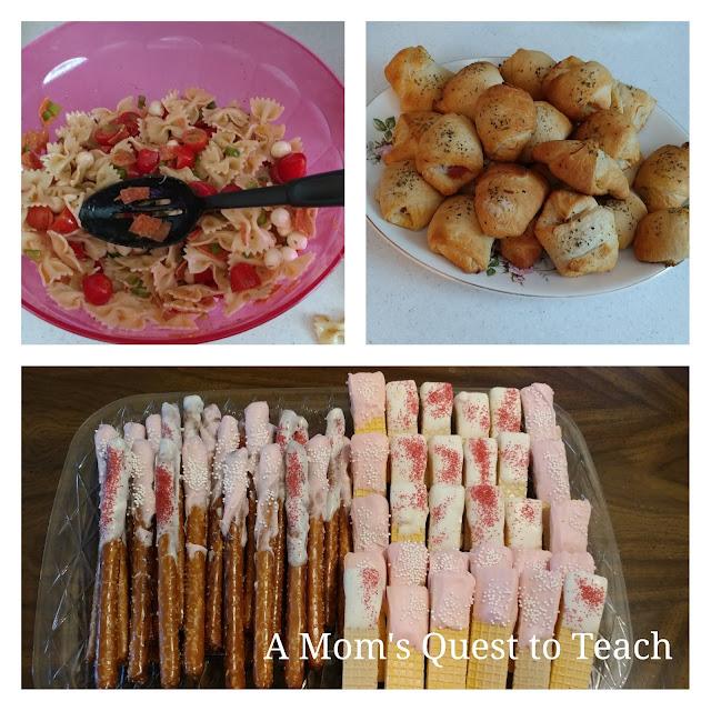 Bow-tie salad, treats, and pizza rolls