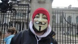 Masked Occupy Belfast protester outside Belfast City Hall